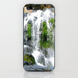 Waterfall over green rocks iPhone Skin