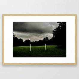 Football goalposts in an empty field Framed Art Print