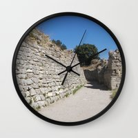caleb troy Wall Clocks featuring Troy by Malcolm Snook