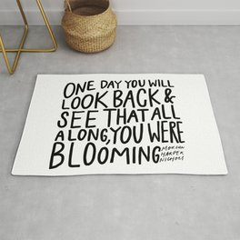 One day you will look back and see that all along, you were blooming Rug