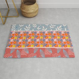Blue, Pink, and Red Color Block Design with Flowers and Plants Rug