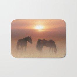 Horses in a misty dawn Bath Mat