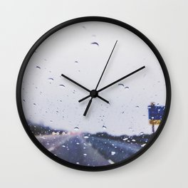 on the road with the rain storm Wall Clock