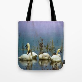 Tundra Swans against a blue and purple background. Tote Bag