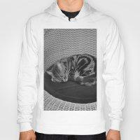sofa Hoodies featuring sleeping cat on sofa by gzm_guvenc