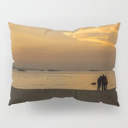 Three people are standing on the beach and below a colorful sundown Pillow Sham