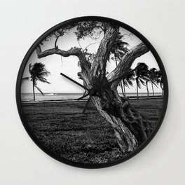 Tree in front of the sea Wall Clock