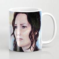 katniss Mugs featuring Katniss Everdeen by Alina Rubanenko