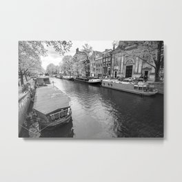 Houseboats docked on canals in Amsterdam Metal Print