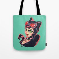 catwoman Tote Bags featuring Catwoman by Piano Bandit