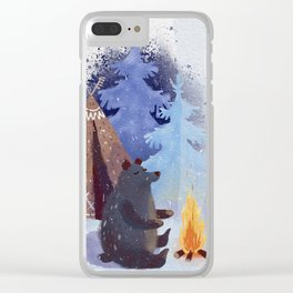 A teddy bear with a wigwam warms its paws by the fire in winter. Clear iPhone Case