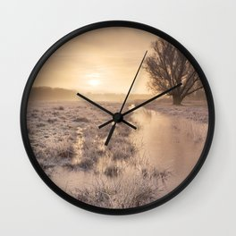 Sunrise over a frozen landscape in The Netherlands Wall Clock