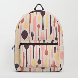 Multicolored cutlery on light background Backpack