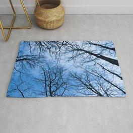 Naked trees tops, blue sky Rug