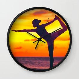 Yoga dancer's pose woman at sunset Wall Clock