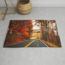 autumnal road in vermont Rug