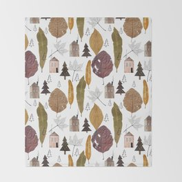 Pattern with autumn leaves and houses and spruces. Throw Blanket