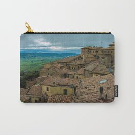 Mountain village with reddish roofs. Cloudy sky over the mountains. Carry-All Pouch