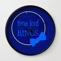 the lord of the rings Wall Clocks featuring Time Lord of the Rings by Michelle Dadoun