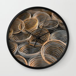 Black, white and orange spiraled coils Wall Clock