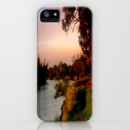 Reflecting sunset on the river Bank iPhone Case
