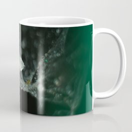 feather on spider web Coffee Mug