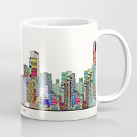oklahoma Mugs featuring oklahoma city skyline by bri.buckley