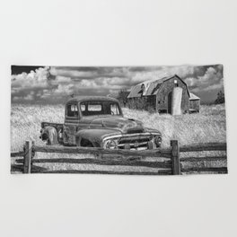Black and White of Rusted International Harvester Pickup Truck behind wooden fence with Red Barn in Beach Towel