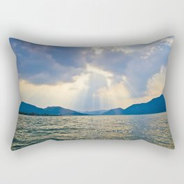 Rays of sunlight shining through the clouds down on a calm ocean Rectangular Pillow