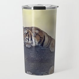 Bengal tiger resting on a rock near pond Travel Mug