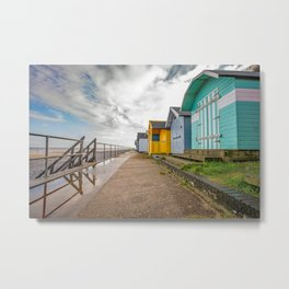 Row of traditional beach huts in the seaside town of Cromer Metal Print
