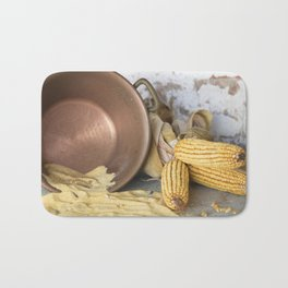 cob and pot with flour Bath Mat