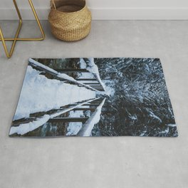 Crossing the river in winter Rug