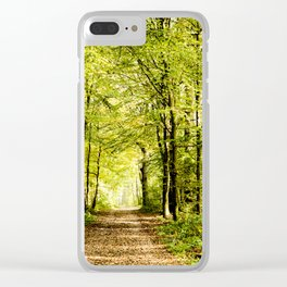 A pathway covered by leaves in a magical forest Clear iPhone Case