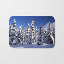 Snow covered trees in the forest. Winter day with blue sky. Bath Mat