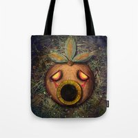 majoras mask Tote Bags featuring Deku Mask by Stephano Herrera