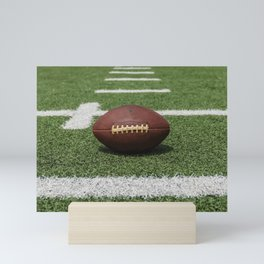 American Football Court with ball on Gras Mini Art Print