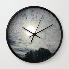 sun behind clouds Wall Clock