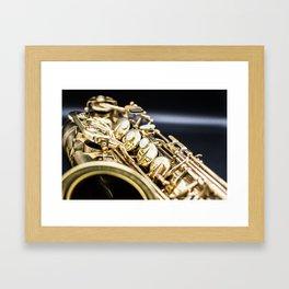 Alto saxophone black background Framed Art Print