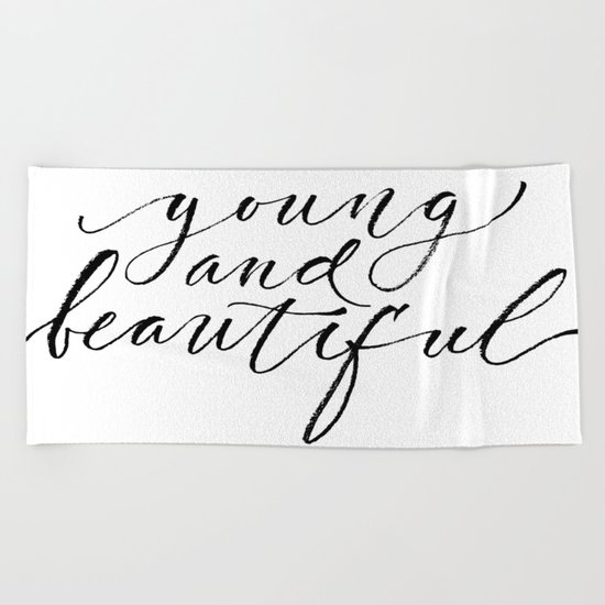 Young and beautiful Beach Towel