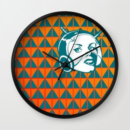 Faces: SciFi lady on a teal and orange pattern background Wall Clock