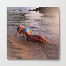 Beautiful young woman on a beach near sea Metal Print