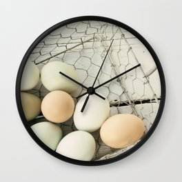 Eggs in one basket Wall Clock