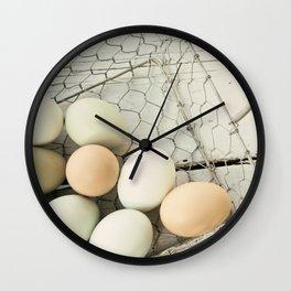 Eggs in one basket Wall Clock