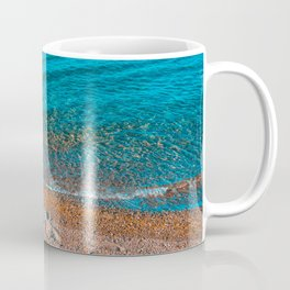 stony beach in orange colors with clean water Coffee Mug