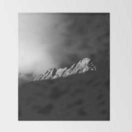 Last sun rays on the mountain in black and white Throw Blanket