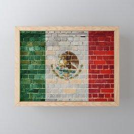 Mexico flag on a brick wall Framed Mini Art Print