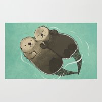 otters Area & Throw Rugs featuring Significant Otters - Otters Holding Hands by StudioMarimo