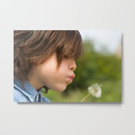 Beautiful little girl blow dandelion outdoor Metal Print
