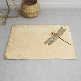 Dragonfly on old handwritten and floral vintage background Rug